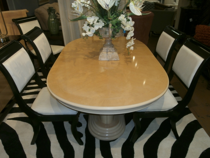 blonde curved dining tble at the missing piece. Black Bedroom Furniture Sets. Home Design Ideas